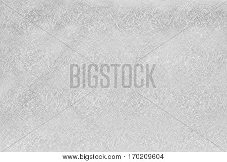 background and abstract spotty texture of textile material or fabric of white color