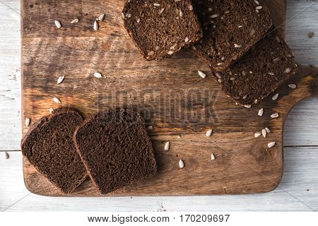 Slices of rye bread on a cutting board closeup horisontal