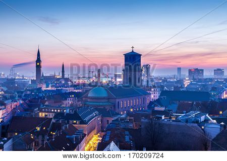 Cityscape of copenhagen in the bluehour Tower of city hall and a church