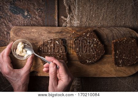 Smearing butter on a slice of bread horizontal