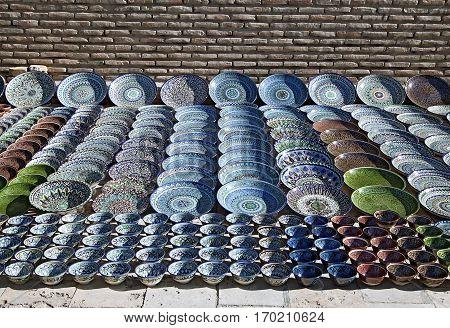 Traditional ceramic dishware in a street market, Uzbekistan
