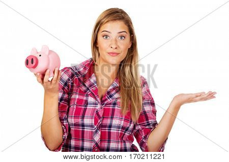 Young woman holding piggybank and gesturing dont know