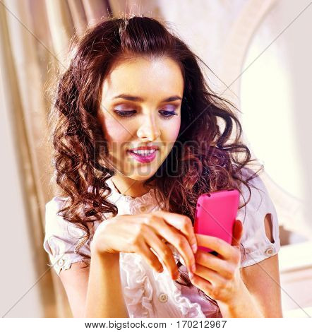 beautiful lovely woman with smartphone in luxury hotel room