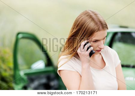 Female criver making phone calls after traffic accident.