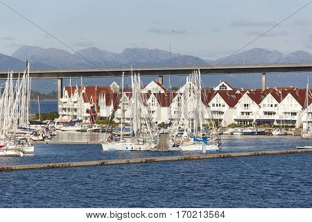 Traditional norwegian harbor village with houses and yatchs. Stavanger. Norway. Horizontal