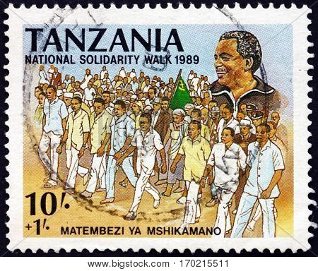 TANZANIA - CIRCA 1989: a stamp printed in Tanzania dedicated to National solidarity walk president Ali Hassan Mwinyi circa 1989