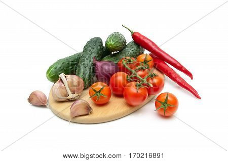 cucumbers tomatoes chili peppers and garlic isolated on white background. horizontal photo.