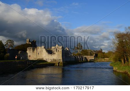 River maigue and ruins of Desmond Castle in Ireland.