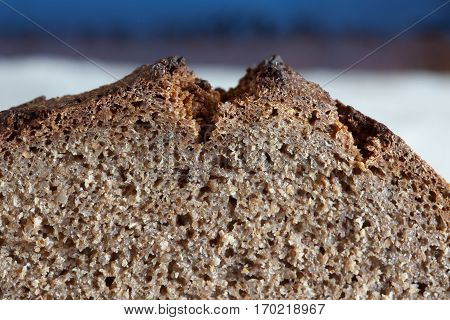 Closeup texture of freshly baked rustic sourdough rye bread traditional lithuanian cuisine.