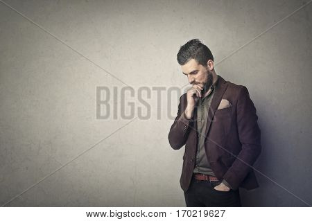 Brown suited man thinking hard