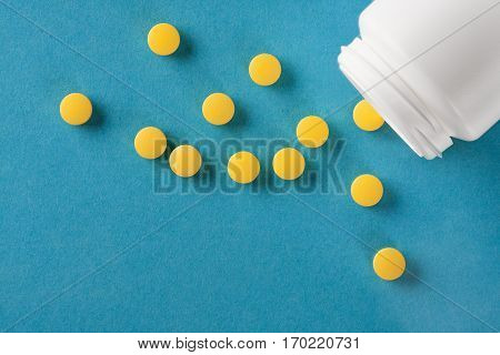 Pile Of Medical Pills And Bank On A Blue Background