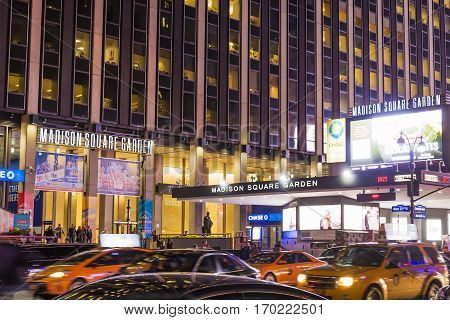 New York USA november 2016: Exterior of Madison Square Garden iIlluminated stadium with car riding around.
