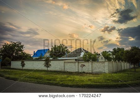 an amazing quiet place countryside during summer sunset with colorful sky