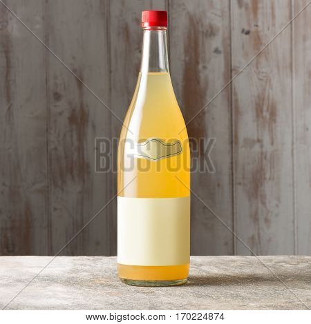 Unlabeled Bottle Of Yellow Liquor