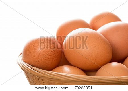 Close Up Of Brown Eggs In Wicker Tray Copy Space