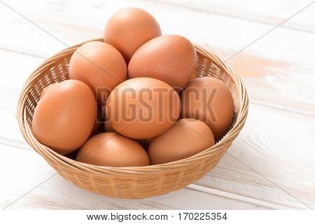 Brown Chicken Eggs In Wicker Tray