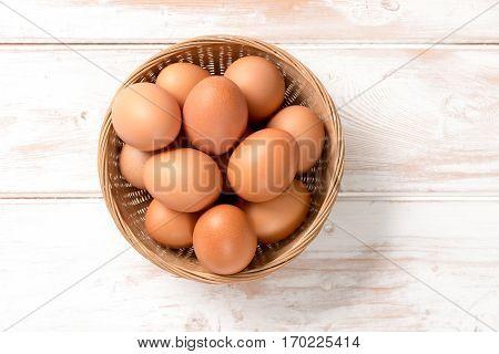 Overhead Of Brown Chicken Eggs In Wicker Tray