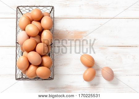 Chicken Eggs In Mesh Tray And On Wooden Background