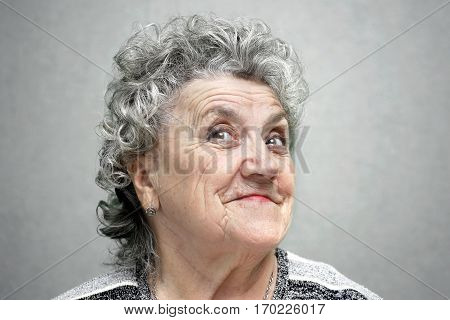 Smile grandmother face on a grey background