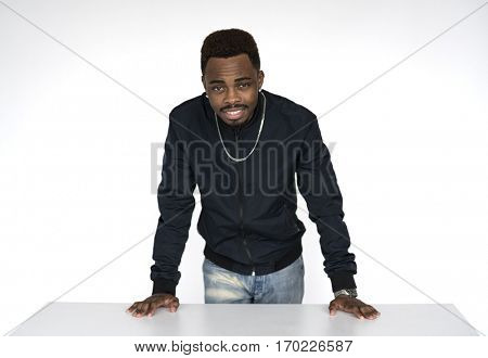 Black guy resting his hands on the table
