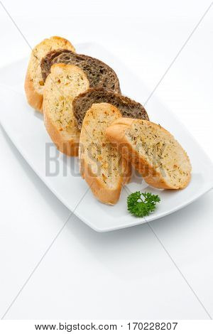 close up view of some bread in plate   on whit back