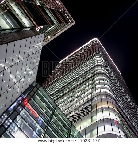 LONDON UK - 10 MARCH 2005: A low angle night view of the modern architecture of the HSBC Tower in London's Docklands business district.