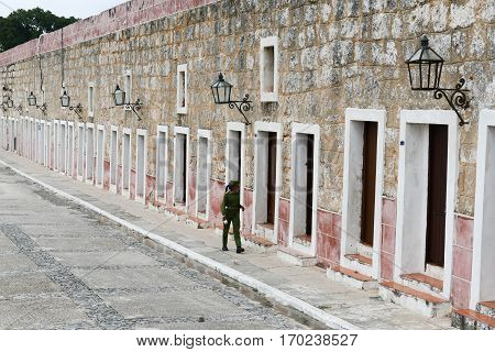 Female Soldier Walking In La Cabana Fortress At Havana