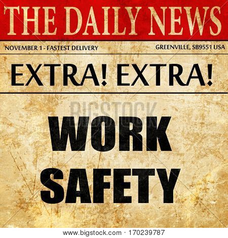 Work safety sign, newspaper article text