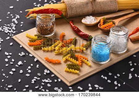 Colorful Fusilli And Bunch Of Spaghetti On Corkboard
