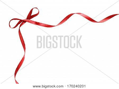Corner with small red silk ribbon bow isolated on white