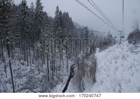 The chairlift ski lifts up the mountains in winter