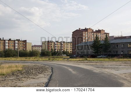 Old two-storeyed and modern many-storeyed building. Сontrast and opposite