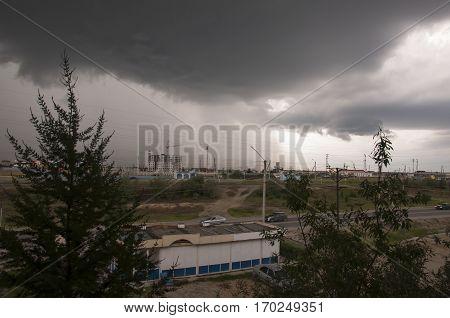 View from the window in the rainy day with dark clouds and bustop