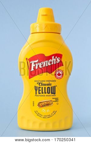 PLEASANT VALLEY CANADA - FEBRUARY 10 2017: French's Mustard bottle on blue. French's is a U.S. brand of mustard and various other food products.