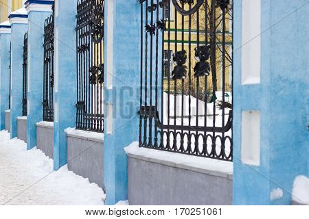 Iron fence on the background of the church. Holy Ascension Cathedral in Ulyanovsk Russia.