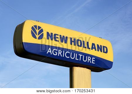 Villars, France - February 2, 2017: New Holland Agriculture logo on a pole. New Holland is a brand agricultural equipment manufactured by CNH Industrial