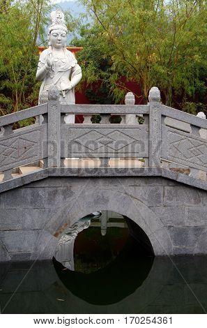 White marble Guanyin statue on the bridge in Nanyue Damiao temple Heng Shan Hunan China