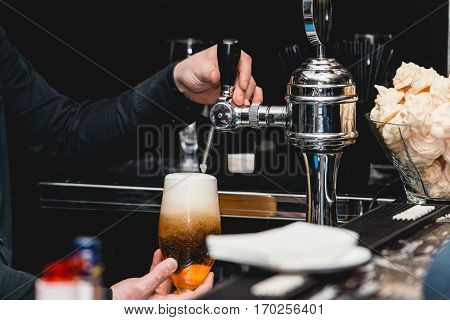 Bartender Pours A Glass Of Light Beer