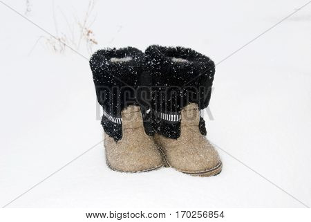 Russian Traditional Winter Felt Boot Valenki On The Snow