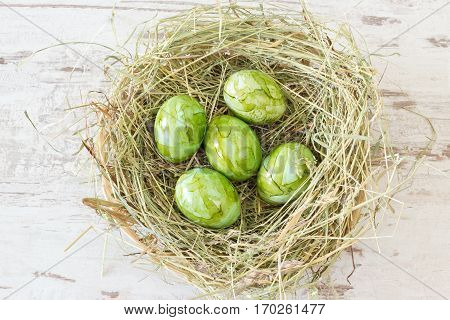 Green Easter Eggs In A Nest