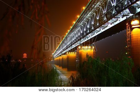 Night View Of Bridge Over Chang Jiang In Wuhan, China