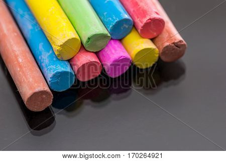 Multi Colored Chalk Isolated On Black Background .