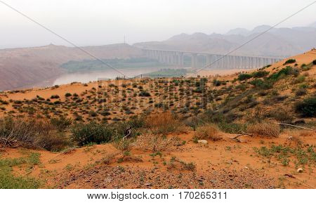 Tengger desert on a background of Yellow river (Huang He) Shapotou district China