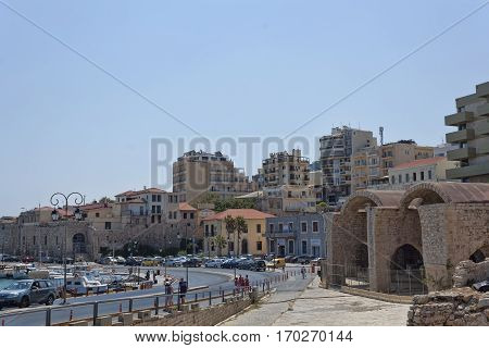 HERAKLION CRETE GREECE - AUGUST 1 2013: On the coastal street of Heraklion. On the right the old Venetian docks. Crete