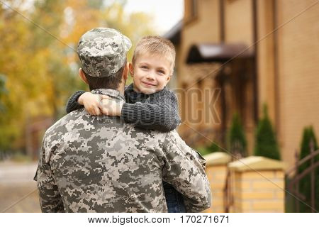 Soldier reunited with his family on a sunny day