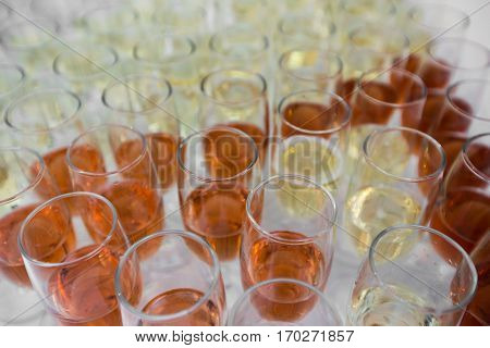 table full with champagne glasses. wite and rose