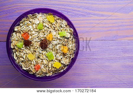 Oatmeal With  Dried Fruit (strawberries, Grapes, Kiwi, Peach) . Oatmeal On A Wooden Table. Oatmeal T