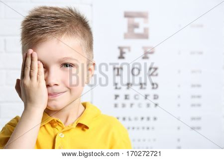 Little boy having eye test at ophthalmologist office