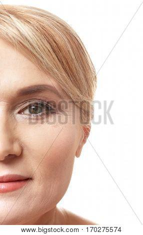 Mature woman on white background, closeup