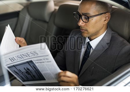 Business Man Sit Inside Car Read Newspaper